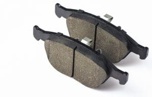 Two brake pad for disc brakes of car on a white background. Spare parts for car maintenance, brake system consumables.